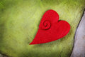 Red heart on green paper Stock Photos
