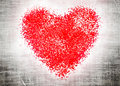 Red heart on grey grangy background