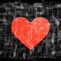 Red heart on grunge black background Royalty Free Stock Photo