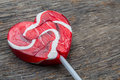 Red heart lollipop concept love valentine on wooden background Royalty Free Stock Image