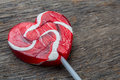 Red heart lollipop concept love valentine on wooden table Stock Photos