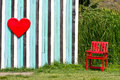 Red Heart and lonely chair Royalty Free Stock Images