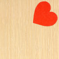 Red heart love symbol on beige bamboo mat valentines day paper copy space for text as concept Stock Images