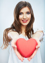 Red heart love symbol portrait of beautiful woman hold valent happy valentine day isolated studio background female model Royalty Free Stock Images