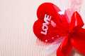 Red heart with love word and ribbon decorate on paper Royalty Free Stock Photography