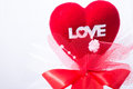 Red heart with love word and ribbon decorate on white background Royalty Free Stock Photo