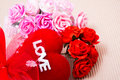 Red heart with love word and roses decorate ribbon on paper Stock Image