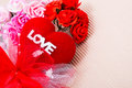 Red heart with love word and roses decorate ribbon on paper Stock Photography