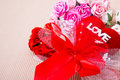 Red heart with love word and roses decorate ribbon on paper Royalty Free Stock Photos