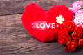 Red heart with love word and roses decorate on wooden table top Royalty Free Stock Photos