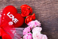 Red heart with love word and roses decorate on wooden table top Royalty Free Stock Images
