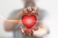 Red heart in male hands Stock Photography