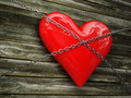 Red heart and metal chain Royalty Free Stock Photo