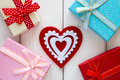 Red heart next to the gift boxes Royalty Free Stock Photo