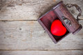 Red heart in the old box on wooden floor Stock Photos