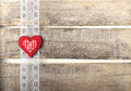 Red heart on old wooden background with lace Royalty Free Stock Image