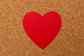 Red heart on pressured cork background love texture valentines day card concept Stock Photography