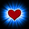 Red heart with rays on a black Royalty Free Stock Photo