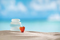 Red heart sea glass seaglass with ocean beach and seascape shallow dof Stock Image