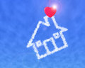 Red heart shape clothespin cloud house in blue sky Stock Image