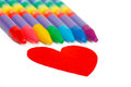 Red heart shape and colored chalks crayons Royalty Free Stock Photos