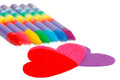 Red heart shape and colored chalks crayons Royalty Free Stock Images