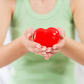 Red heart shape health love support care in female hands Stock Images