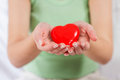 Red heart shape health love support care in female hands Royalty Free Stock Images