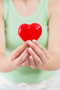 Red heart shape health love support care in female hands Stock Photography