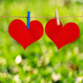 Red heart shape on note paper attach to rope with clothes pins green bokeh background Stock Image