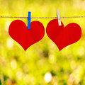 Red heart shape on note paper attach to rope with clothes pins yellow bokeh background Stock Image