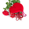 Red heart-shaped casket with beads of  semi-precious stones Royalty Free Stock Photography