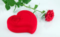 Red heart-shaped casket and rose Stock Photos