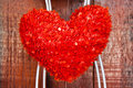 Red heart shaped of hanging over wood background Royalty Free Stock Photography