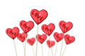 Red heart shaped lollipops white background Stock Images