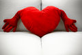 Red heart shaped pillow a with an armchair Royalty Free Stock Images