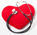 Red heart and stethoscope Stock Photos