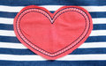 Red heart textile on a striped background Stock Photo