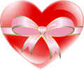 Red heart tied with pink ribbon Royalty Free Stock Image