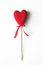 Red heart on a white background on a stick Stock Images