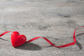 Red heart on wooden background with ribbon old valentines day Stock Photos