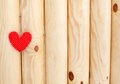Red heart on a woody background Stock Photos