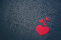Red hearts different size on a black background - symbol of love and valentines day background. Place for writing text. Love conce