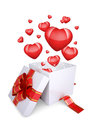 Red hearts fly out of an open gift box the concept valentine s day Stock Image