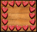 Red hearts frame on wooden boards many damaged with nails Stock Images