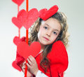 Red hearts girl in clothes with paper handmade Stock Photos
