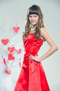 Red hearts girl in clothes with paper handmade Royalty Free Stock Image