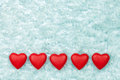 Red hearts on the ice five Royalty Free Stock Photos