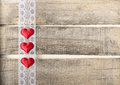 Red hearts on old wooden background three with lace Stock Photos