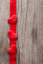 Red hearts and ribbon frame wooden background for valentines Stock Photos